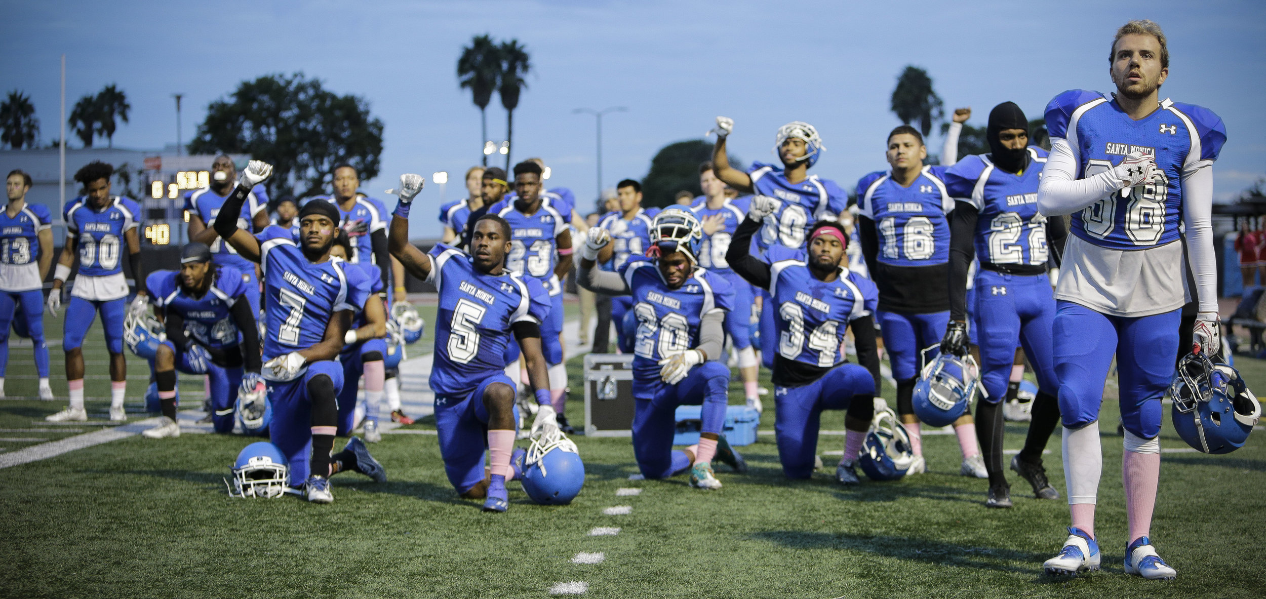 Teamates on The Santa Monica College Corsair mens football team continue to kneel in recognition for #BlackLivesMatter during the National Anthem before the teams Homecoming game. The Corsairs football team would loose at home 26-14 in Santa Monica , Calif. on October 29nd . (Photo By: Daniel Bowyer/Corsair Staff)