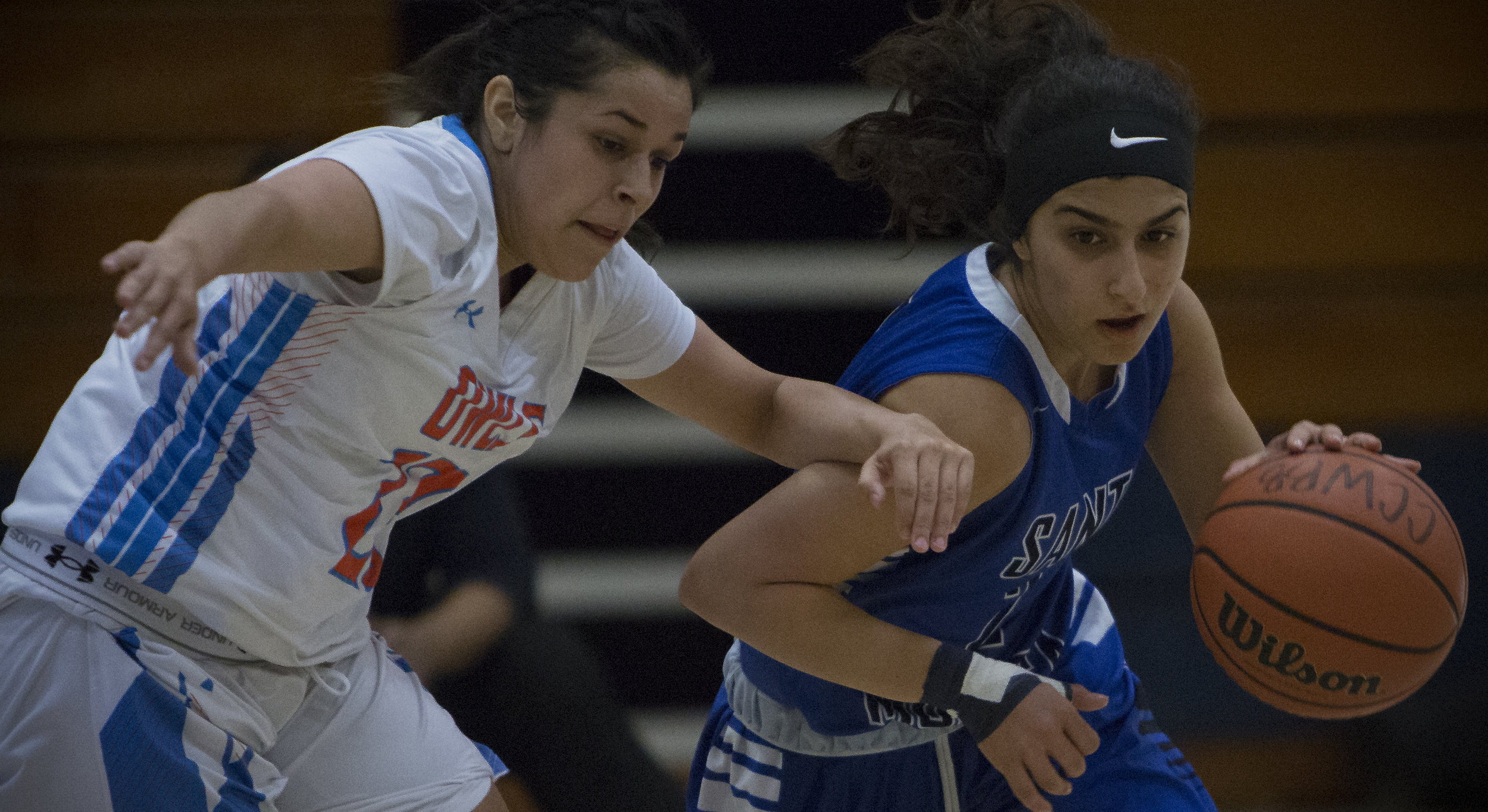 December 4th 2016. The Santa Monica College Corsair Womens Basketball team freshman guard (2) Jessica Melamed (blue,right) dribbling past The Citrus College Owls freshman guard (23) Cassandra Martinez (white,left) in the 33rd annual Lady Charger Classic basketball tournament hosted by Cypress College in Cypress, Calif.. The Corsairs would win 74-69 earning them third place in the tournament. Photo By: Daniel Bowyer/Corsair Staff