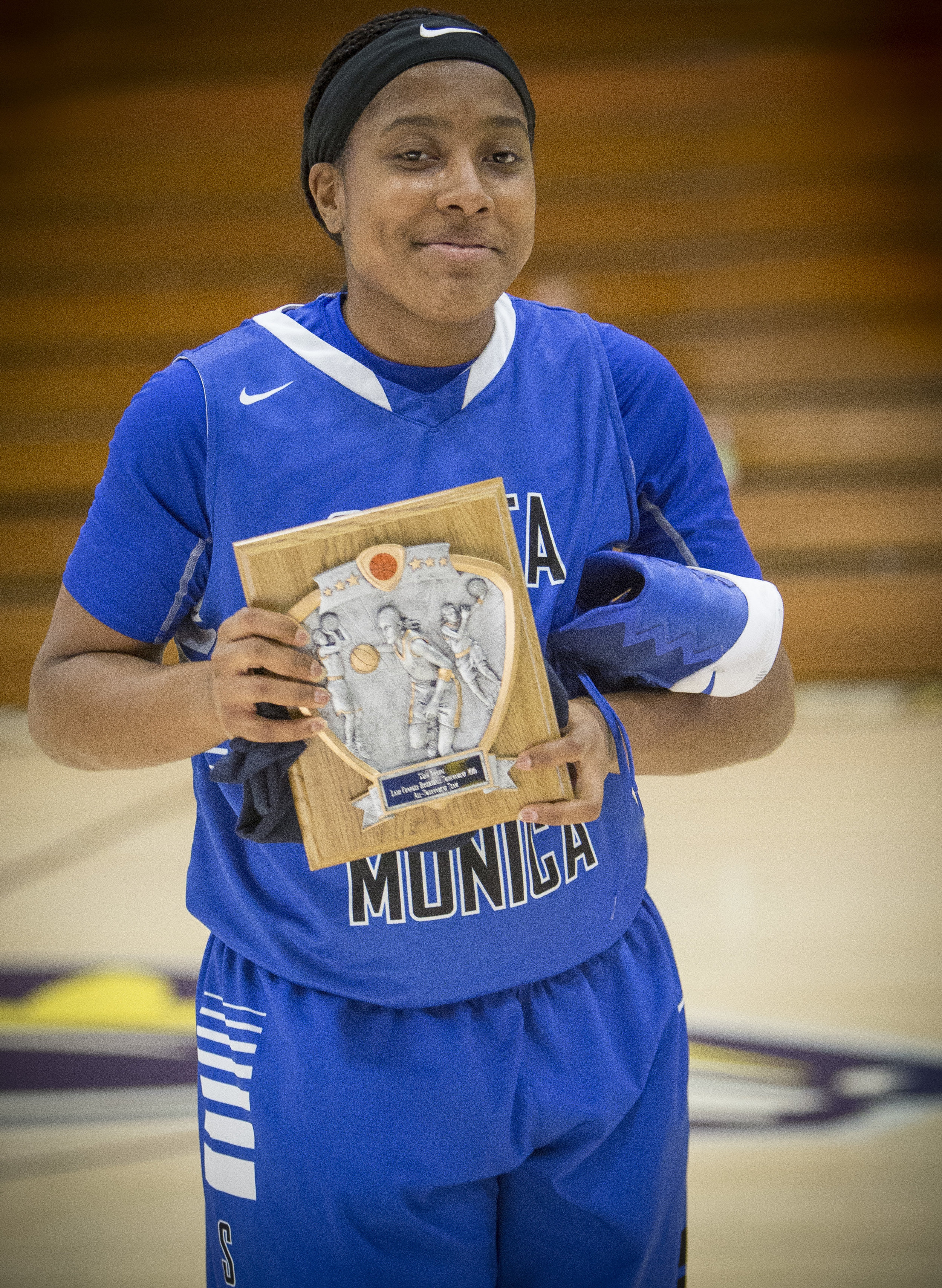 December 4th 2016. The Santa Monica College Corsair Womens Basketball team freshman forward (15) Lauren Davis wins an all team player award in the 33rd annual Lady Charger Classic basketball tournament hosted by Cypress College in Cypress, Calif.. The Corsairs would win 74-69 against The Citrus College Owls earning them third place in the tournament. Photo By: Daniel Bowyer/Corsair Staff