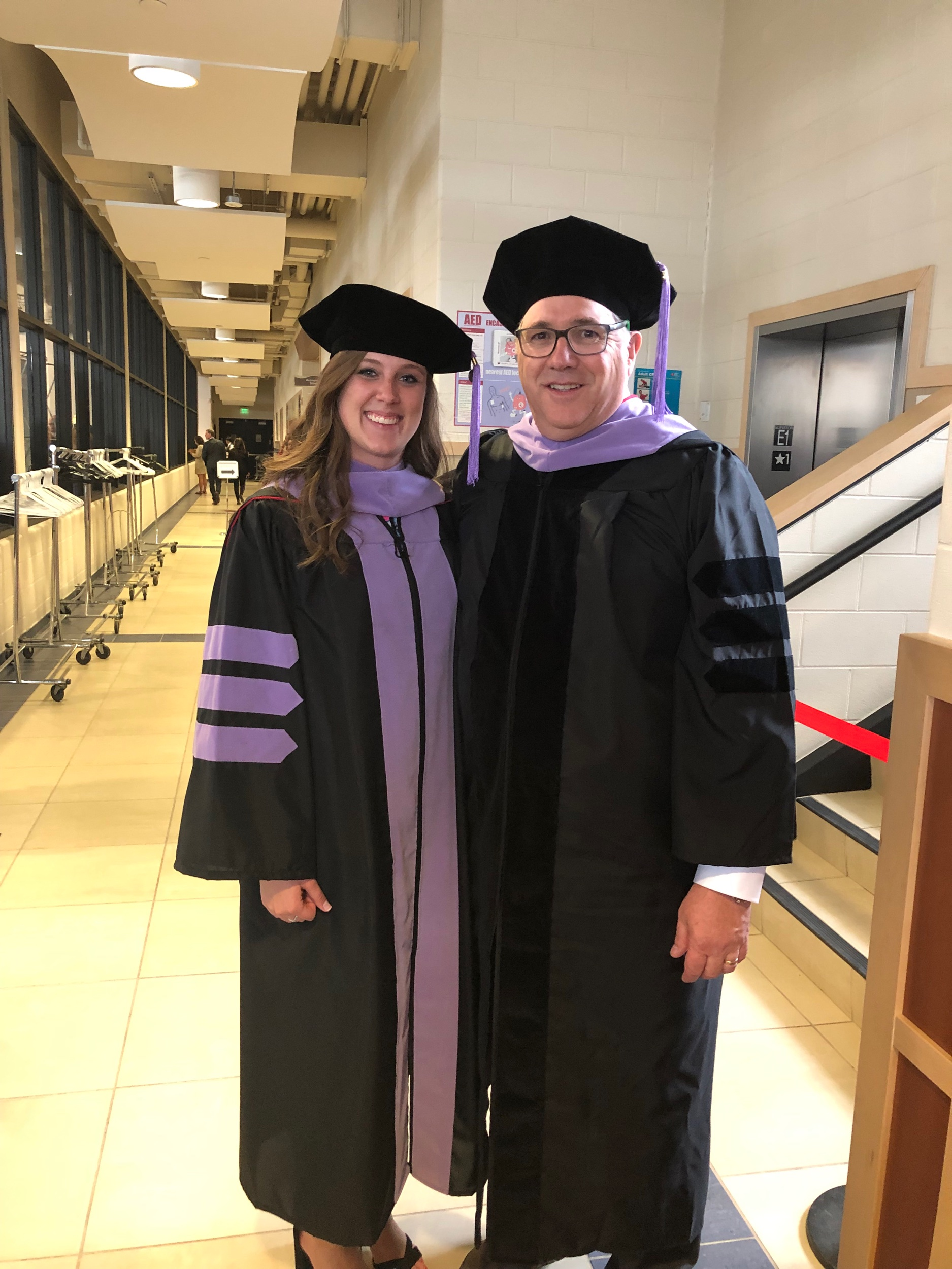 Dr Thornley was honored to participate in the hooding ceremony for Kelly, as her mentor.