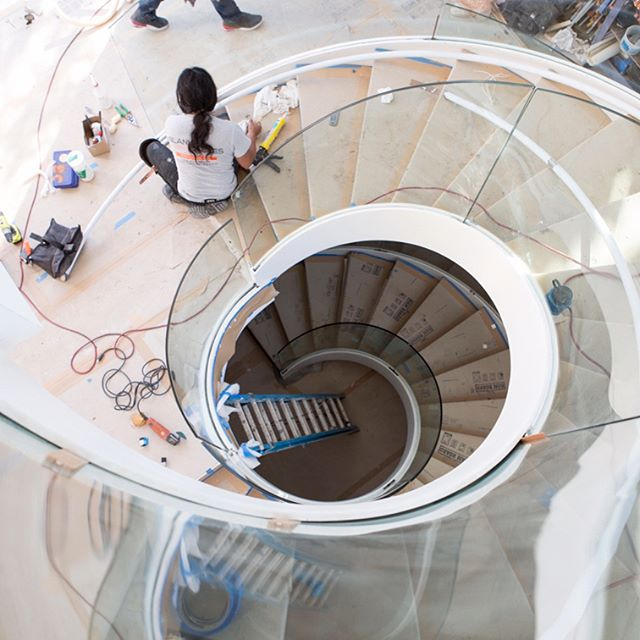 These #oneofakind, breathtaking, #curvedsteel and #glassstaircases with adjacent #steel and #acrylic #suspendedbridge, currently make this private residence a future classic, to be held in high regard, for its bold architectural statement and #innovativedesign. Prior to installation, Blank and Cables transported the behemoth, spiraling steel frames from our #fabricationfacility, to the project site, where a large crane and our skilled crew awaited their arrival. The staircases were then lifted, assembled and welded on-site. #Curvedglass panels, which stretch from the basement to the top floor, were then installed, as well as the steel, #glass and #sandedacrylic bridge; the latter extending over the entryway below. The final compliments to the staircases are the winding #stainlesssteelhandrails and #solidriftwhiteoak treads, all of which perfectly accentuate this future #modernmasterpiece.  View the work in progress shots for the Yee-Yeh project on the Blank and Cables Blog http://blankandcables.com/custom/yee-yeh