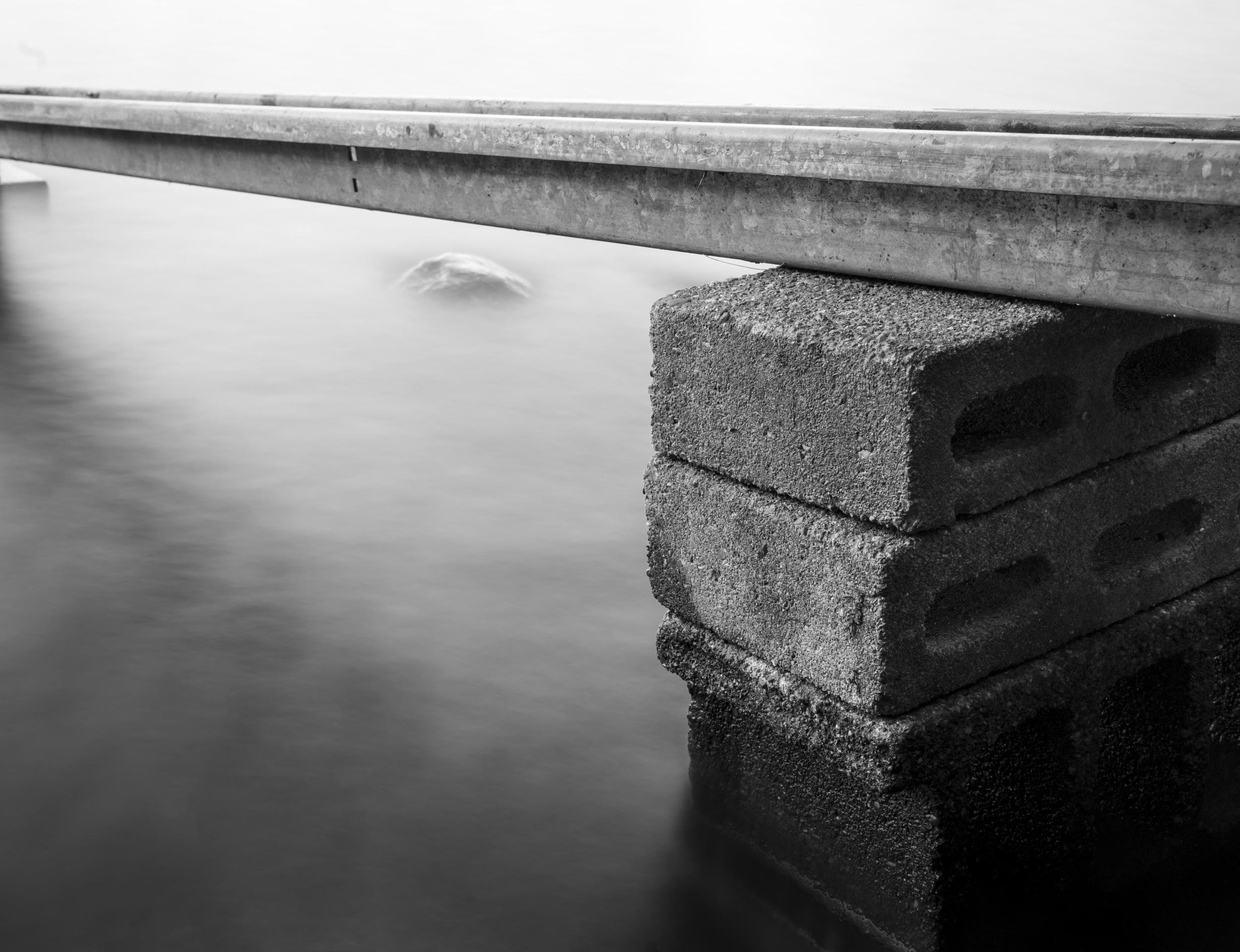 Track on cement blocks into water.jpg