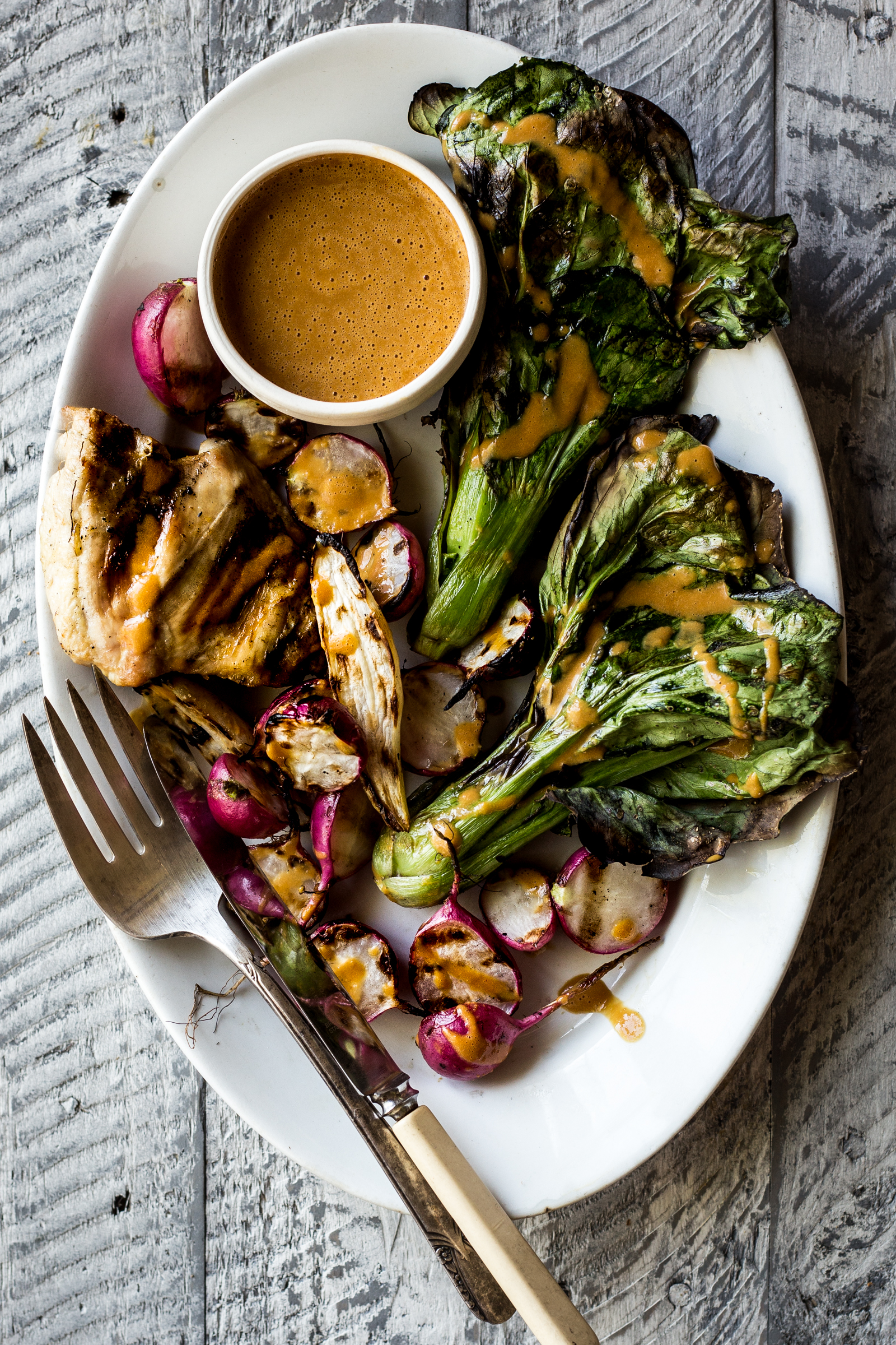 Grilled Chicken with Charred Bok Choy  , Radishes & Spicy Peanut Sauce  (substitute the radishes for turnips!)