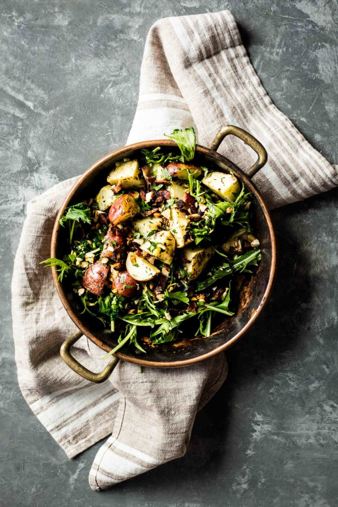 Garlicky Roasted Potatoes with Wilted Greens and Bacon Gremolata
