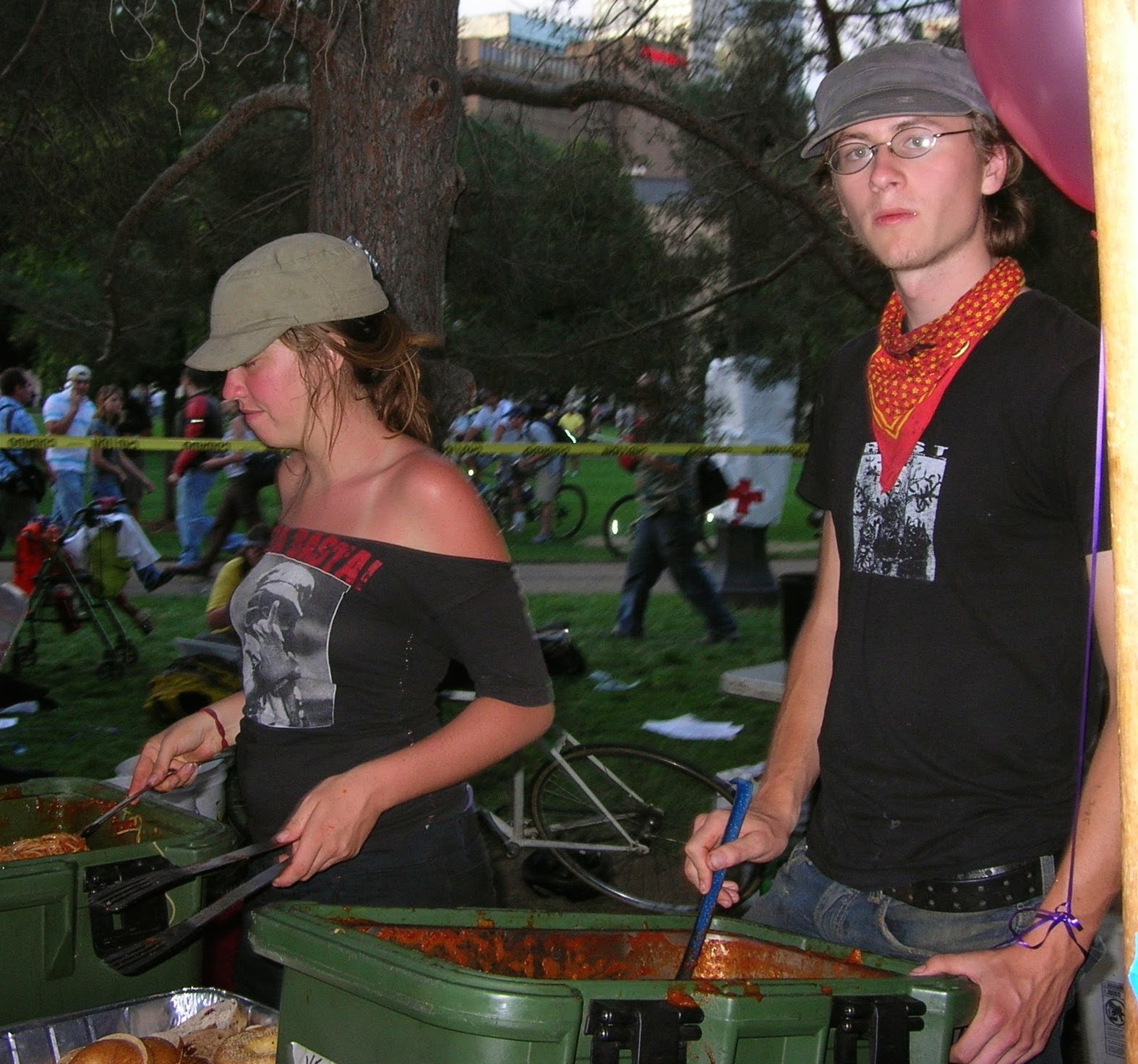 Anarchists serving food in park.jpg