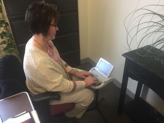 York County Chief Court Reporter Christine Myers shows how she uses a stenotype machine for shorthand use during court hearings.(Photo: Maria Yohn)
