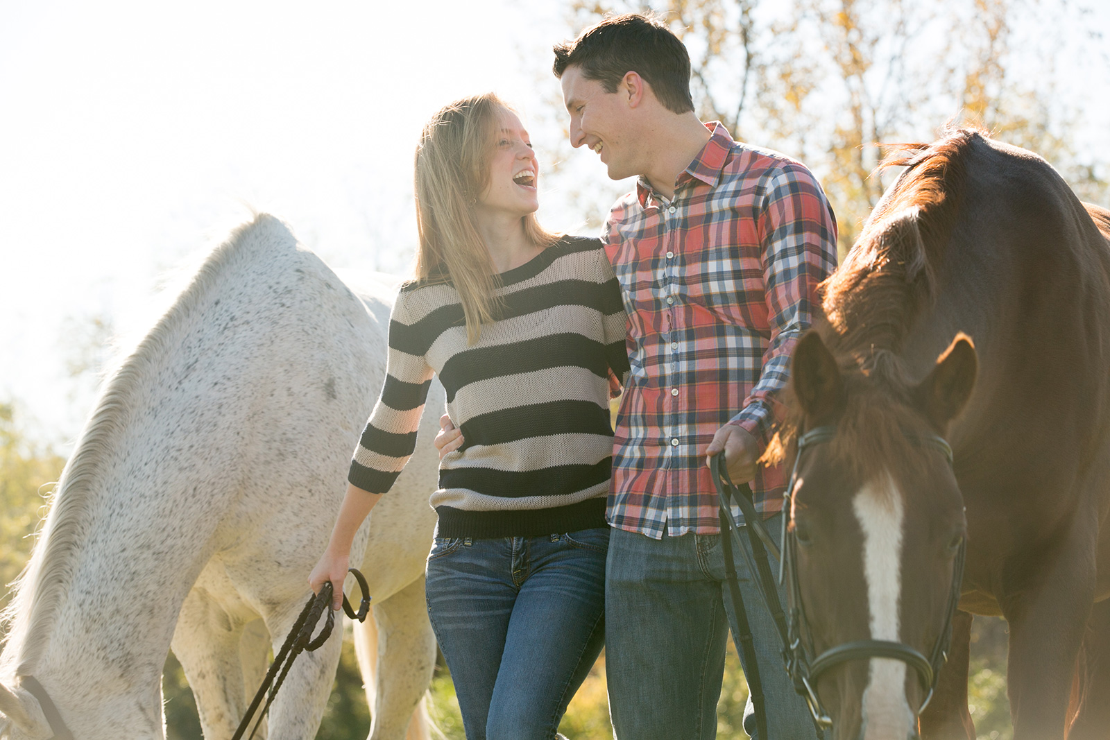 happy-couple-in-horse-park-chicago-engagement-photographer.jpg