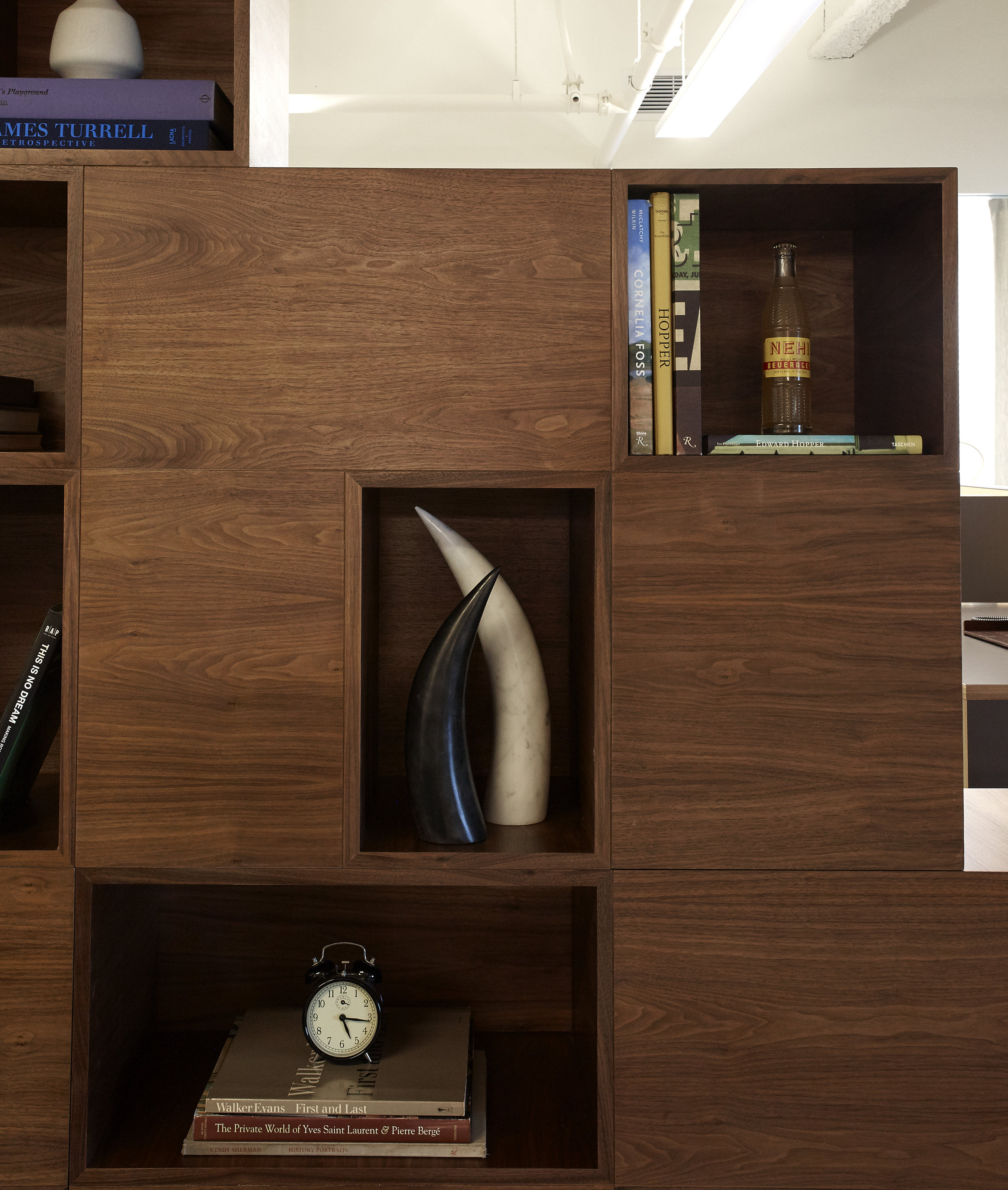 - Because the company derives most of their content from literary sources, we designed a bookshelf-divider and filled the reception side with vignettes that nod to the founder's favorite films, and the core cinematic elements of drama and timing.