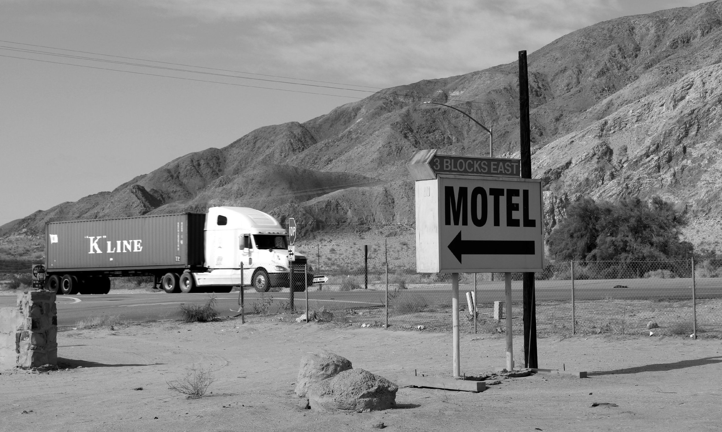 A big rig passes an old motel sign at Desert Shores along the former U.S. 99, now State Route 86, at the western edge of the Salton Sea.  ©  Stephen H. Provost, 2014.