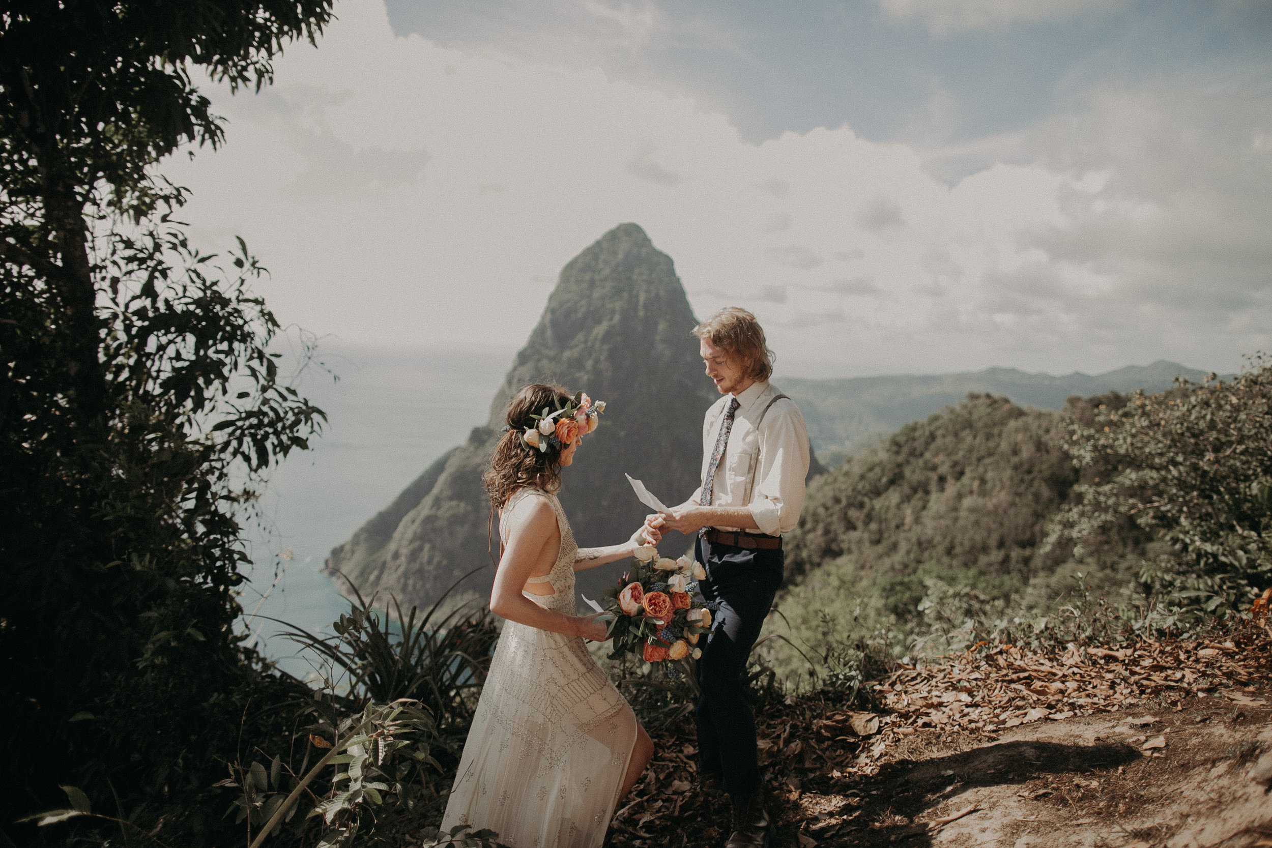 Laura & Josh - St. LuciaOk this elopement takes the cakkkke. Laura and Josh came all the way from Tennessee to elope and it involved hiking to some epic views to say their vows, skateboard rides, and ending with a jump in the pool.