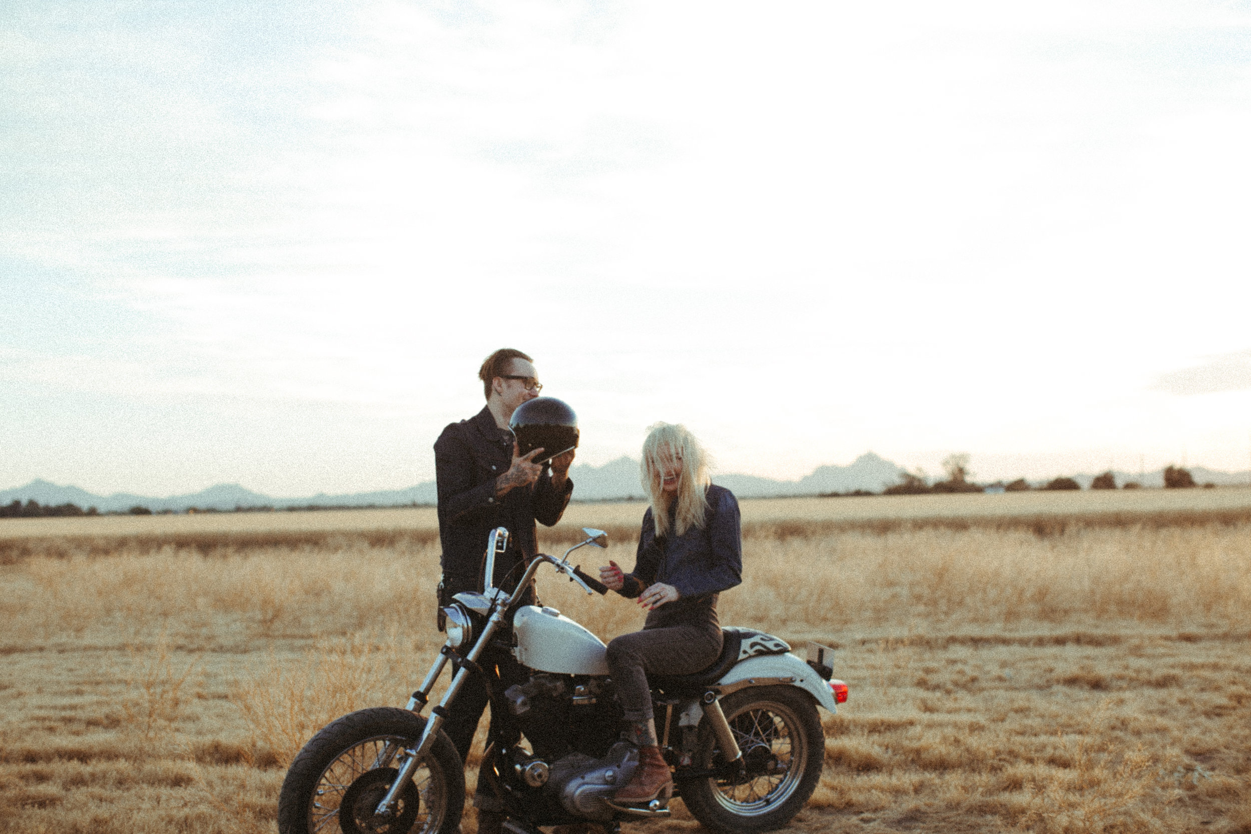 Miranda + Aiden's country engagement .. with a touch of badass. - So we were suppose to shoot in the desert in Tucson with some cacti … then I drove past this random field and knew this would be perfect, and it so was. His bike in that beautiful soft grass, ugh. I could hang these on my wall.