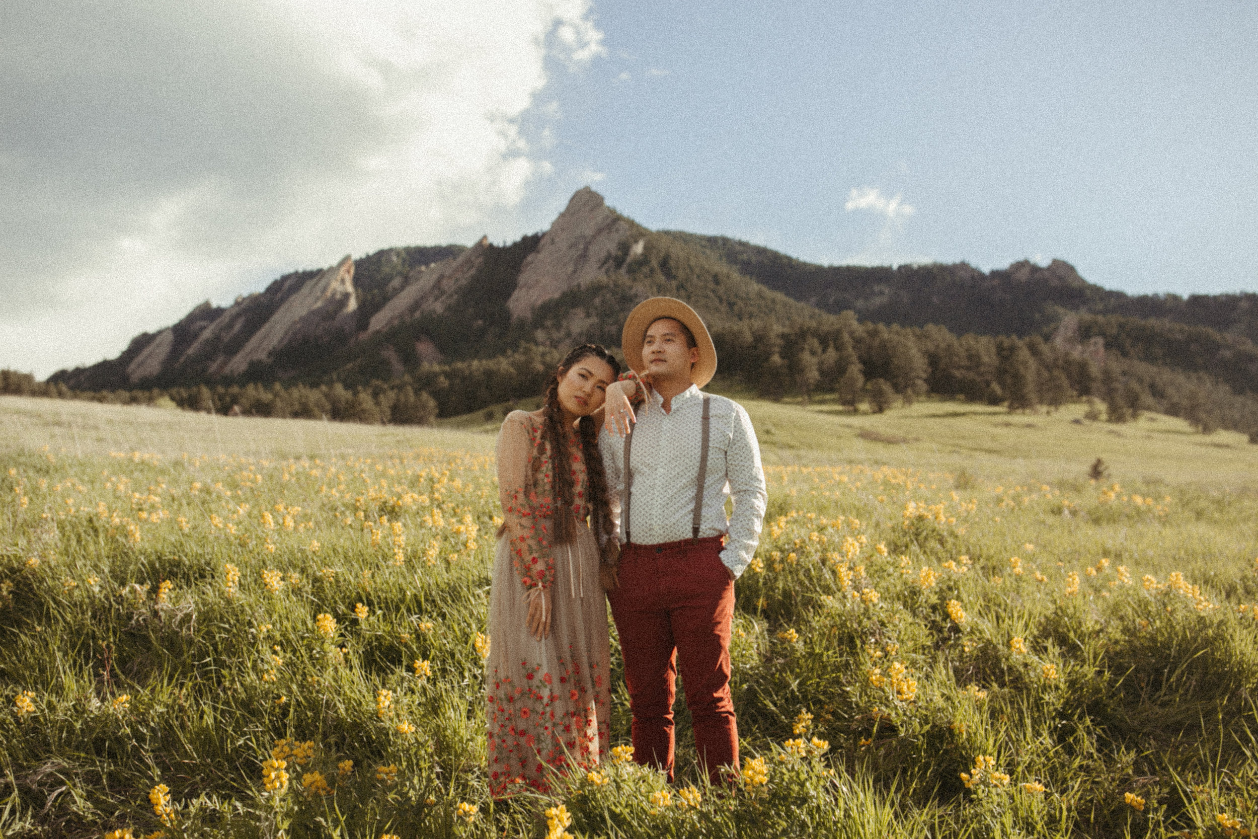 Liz + Nate's timeless mountain engagement - I know, timeless is such an old lady word but that's the vibe I was getting and I'm all about it. This session gives me a little bit of Wes Anderson vibes with a touch of little house on the prairie. Also, ok Liz, yes I see you with those hair goals.
