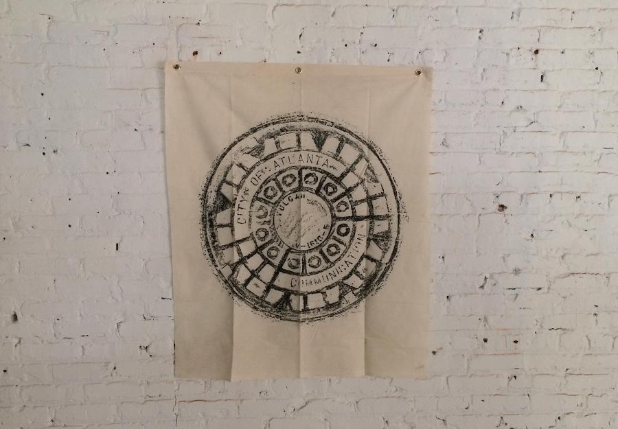 "ATL COM   - Size 37.5""x37.5"" (100% Cotton) - Wax Rubbing of a manhole cover - Print size 30""x30"""