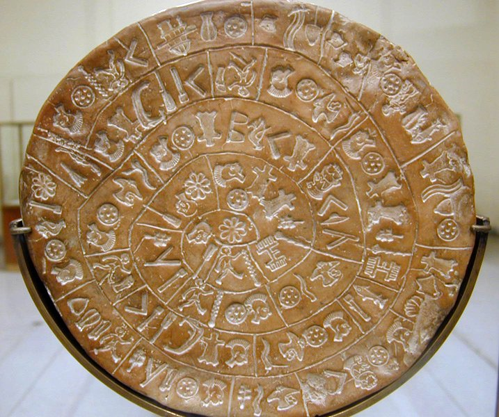 The Phaistos Disc - can you figure out the symbols? (Picture by Jean-Pierre Dalbéra)