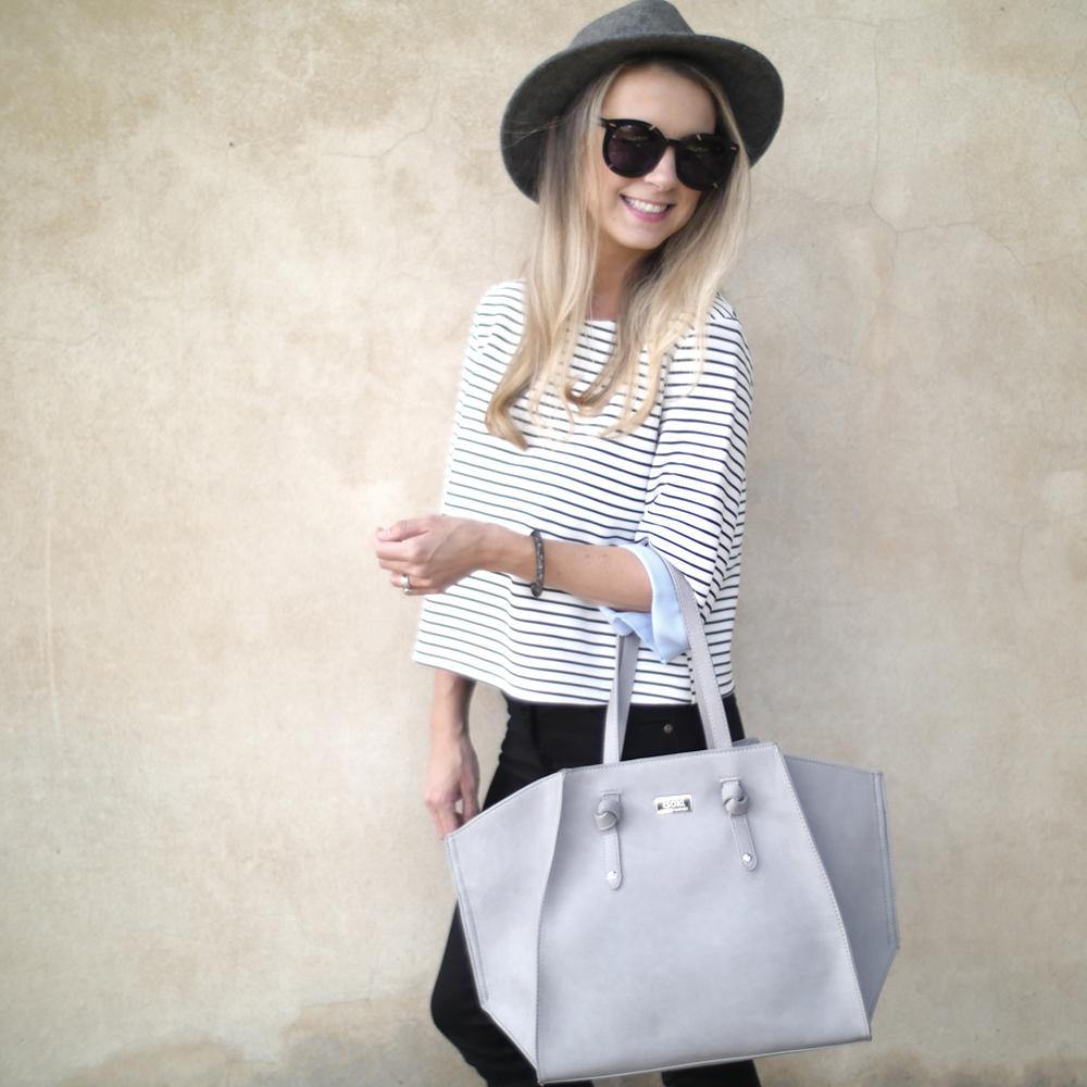 Wearing:  Isoki baby bag , Rollas jeans, Swarovski bracelet similar  here ,  Oliver Bonas  hat similar  here ,  I Love Friday  top similar  here