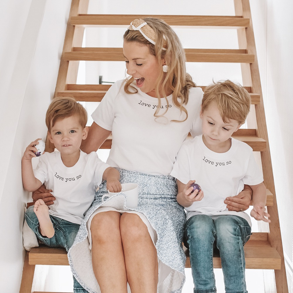 Mum with two sons wearing white tshirt and headband