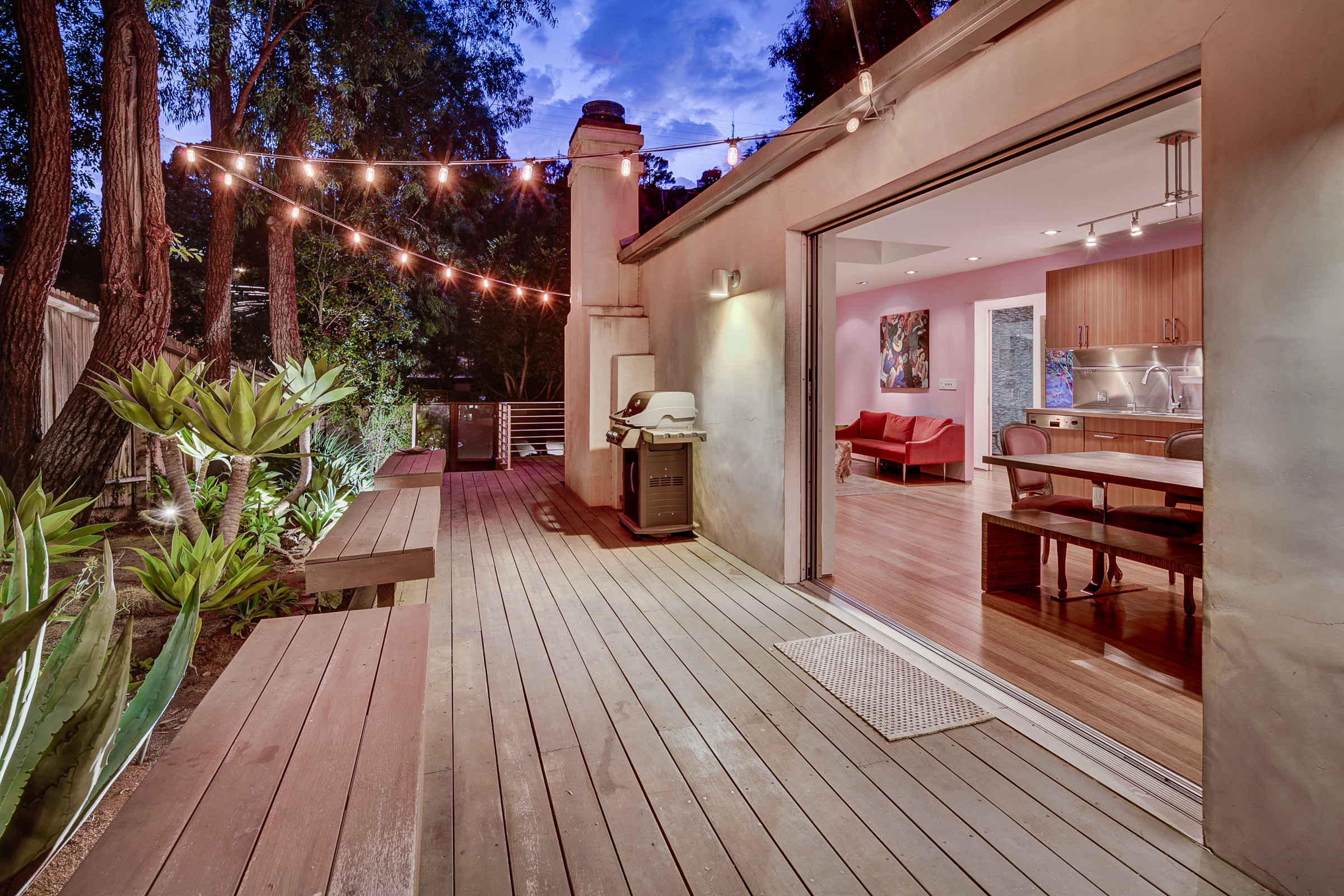 2050 stanley hills drive-23 deck to living room and dining room at twilight.jpg