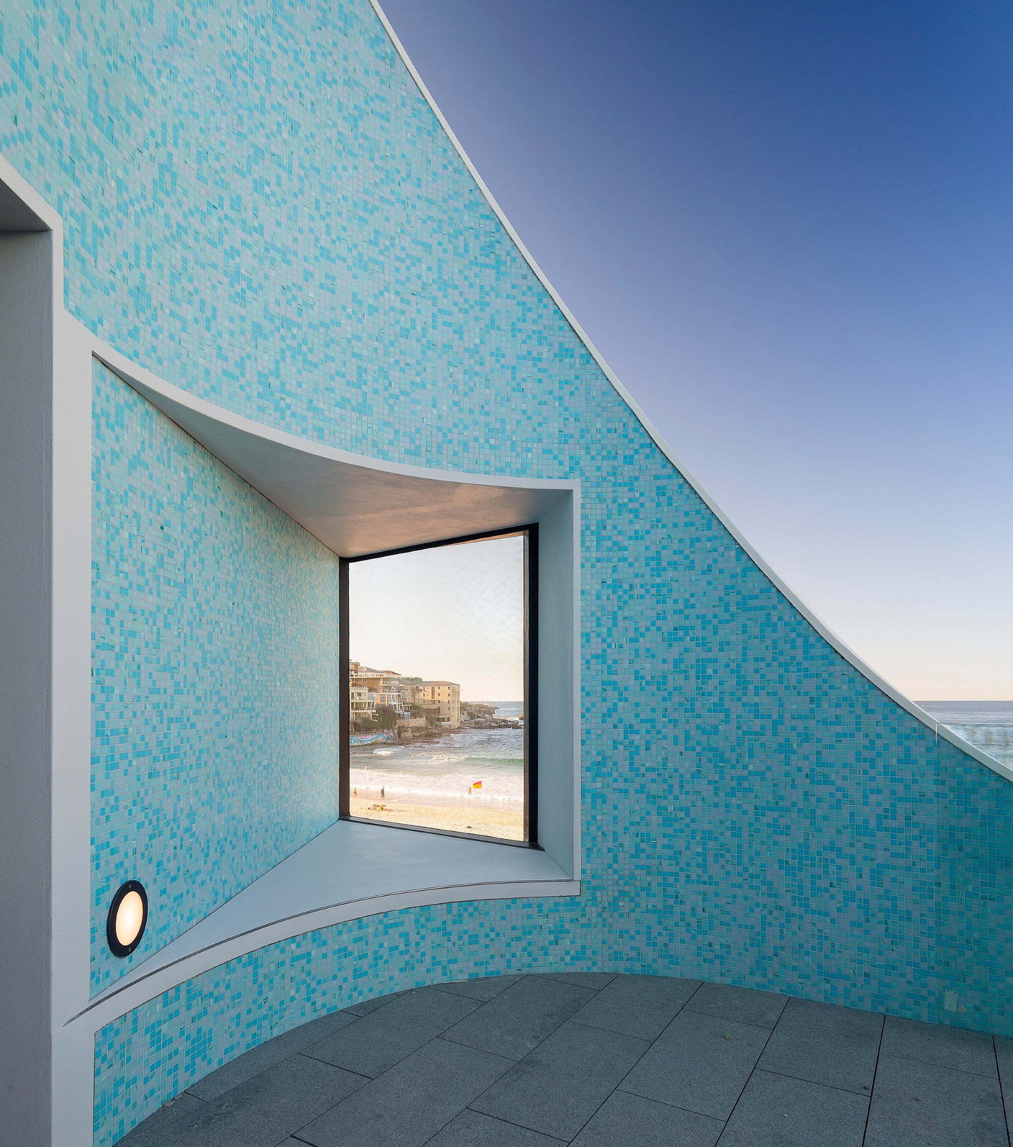 The million dollar view of Bondi Beach from the @northbondislscclubhouse. Sunday drinks from this balcony are famous! The award winning building, designed by architects@DurbachBlockJaggers, was opened in September 2013 and is now considered Australia's most iconic surf lifesaving clubhouse.#bondibeach #northbondiPic: Durbach Block Jaggers