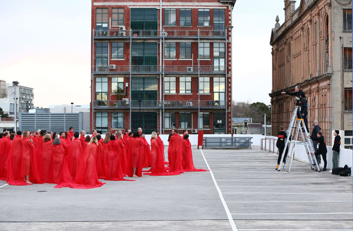Around 500 people braved the Australian winter to pose for a series of controversial nude photographs on top of a Melbourne parking lot.  The photo shoot, which was organized by American artist Spencer Tunick, took place this morning in temperatures of approximately 48 degrees Fahrenheit. It comes just weeks after supermarket chain Woolworths reversed its decision to ban the event from its premises.