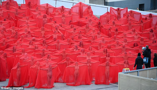 Hundreds of people have bared their private parts in frosty conditions in the name of art.  About 500 converged in  Melbourne  Monday morning for the second of US artist Spencer Tunick's mass nude photo shoots for the Provocare Festival of the Arts.  Temperatures hovered around nine degrees as hundreds made their way towards the Prahran Woolworths rooftop carpark, on Chapel Street in the inner city.