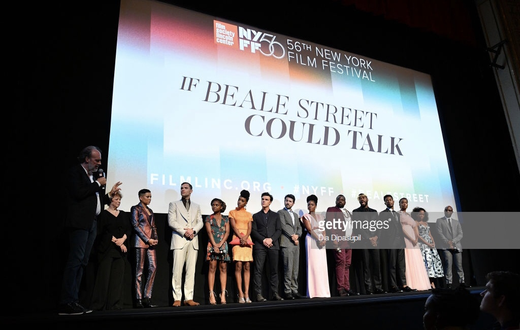 "NEW YORK, NEW YORK - OCTOBER 09: (L-R) Kent Jones, Marcia Jean Kurtz, Emily Rios, Ed Skrein, Dominique Thorne, Ebony Obsidian, Finn Wittrock, Diego Luna, Teyonah Parris, Brian Tyree Henry, Colman Domingo, Stephan James, KiKi Layne, Regina King, and Barry Jenkins speak onstage at the ""If Beale Street Could Talk"" U.S. premiere Q&A during the 56th New York Film Festival at The Apollo Theater on October 09, 2018 in New York City. (Photo by Dia Dipasupil/Getty Images)"