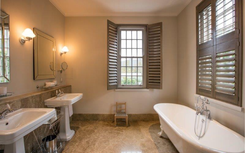 Leeu Estates Deluxe Room Bathroom LC.jpg
