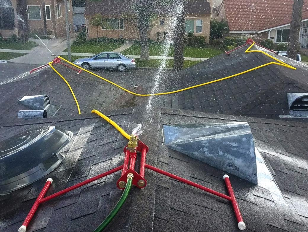 Rooftop sprinkler system; Image from Ember-S-Guard Rooftop Sprinkler Company