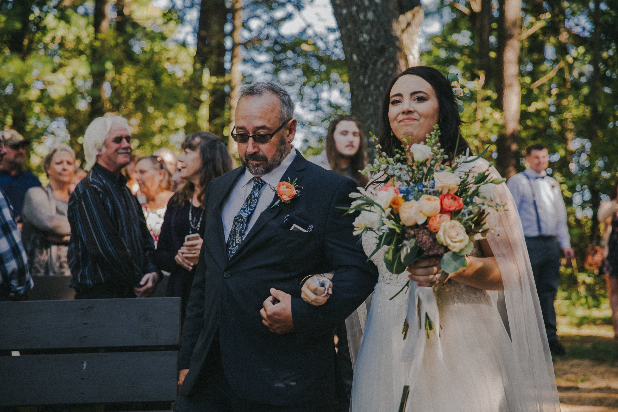 "My dad walked me down the aisle to ""Sweet Caroline""; a song that was always associated with my grandparents and the bar they owned. That bar was the center of our grandparents' and parents' friendships."