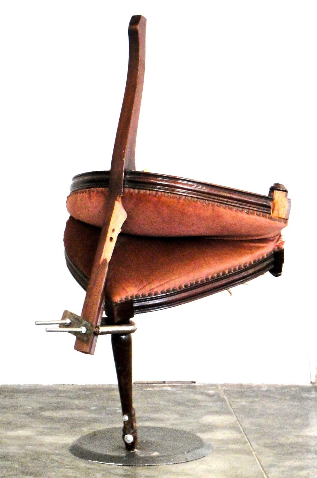 """Re-assembled chair, steel, resin, fiberglass. 35"""" x 23"""" x 15"""