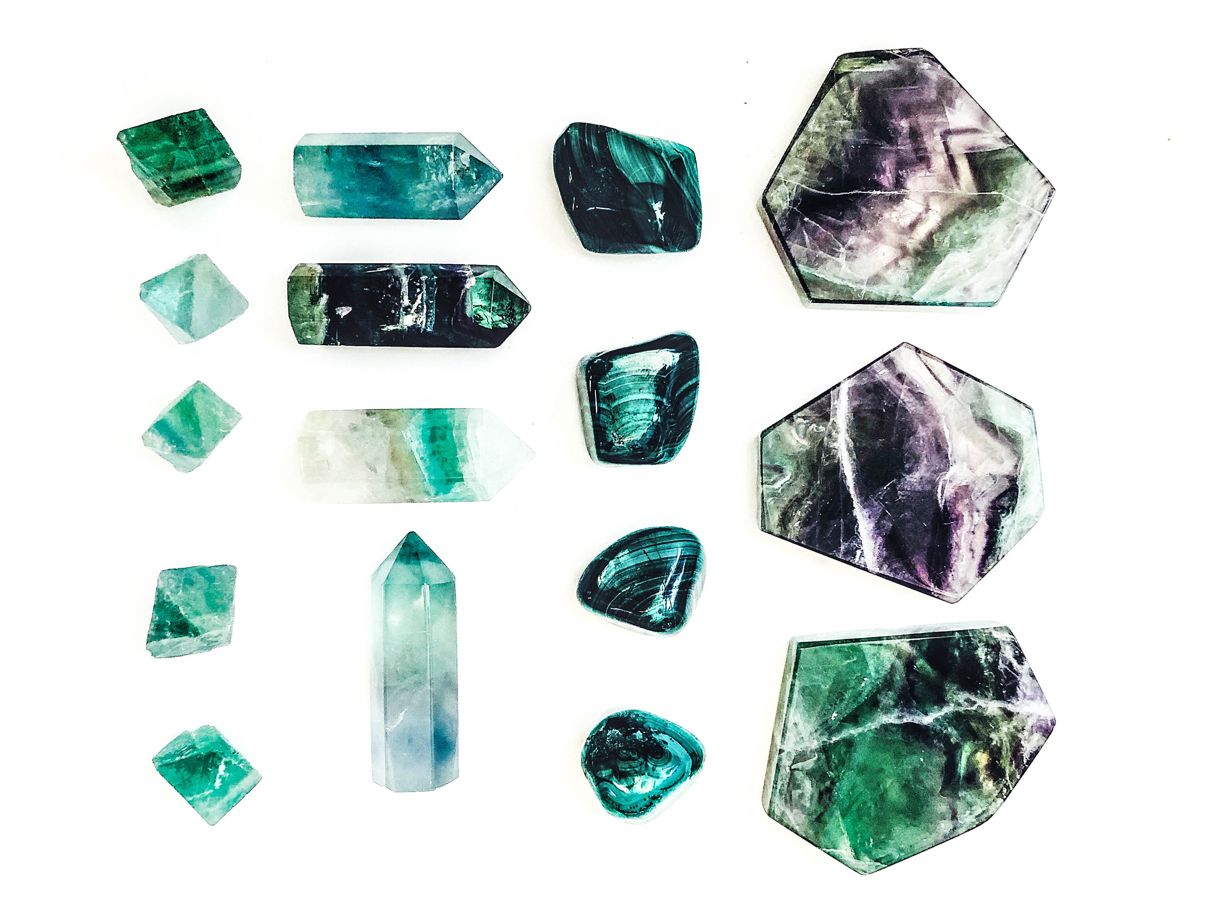 Left to right: Raw Fluorite Octahedron, Fluorite Points, Malachite, Fluorite Slabs.  These are great for mental clarity. Malachite is the great stone of transformation and wonderful for traveling.