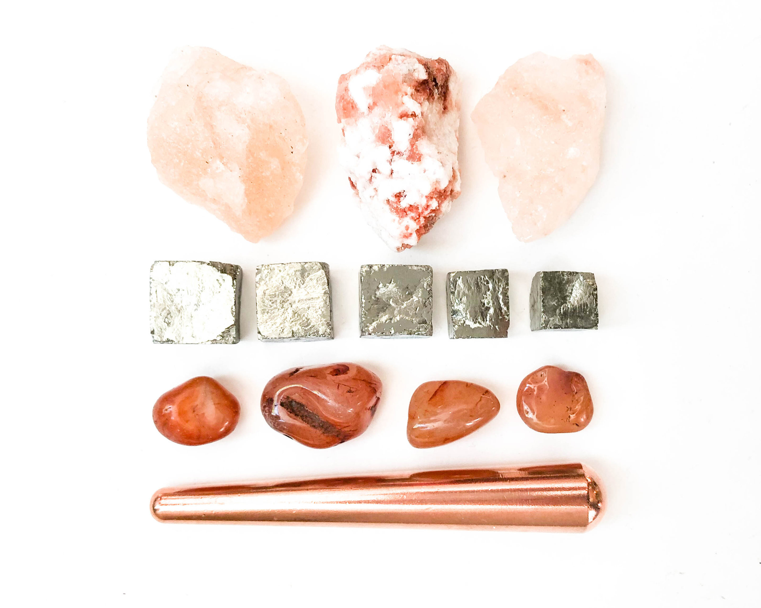 "Top to Bottom: Himalayan Salt Rocks, Pyrite Cube, Carnelian, Copper Wand.  This is the fire series. Copper is a   conductor. Carnelian is great for blood flow and energy. These are the ""just do it"" of the mineral family. Rock salt ionizes the air, protects, and removes negativity."