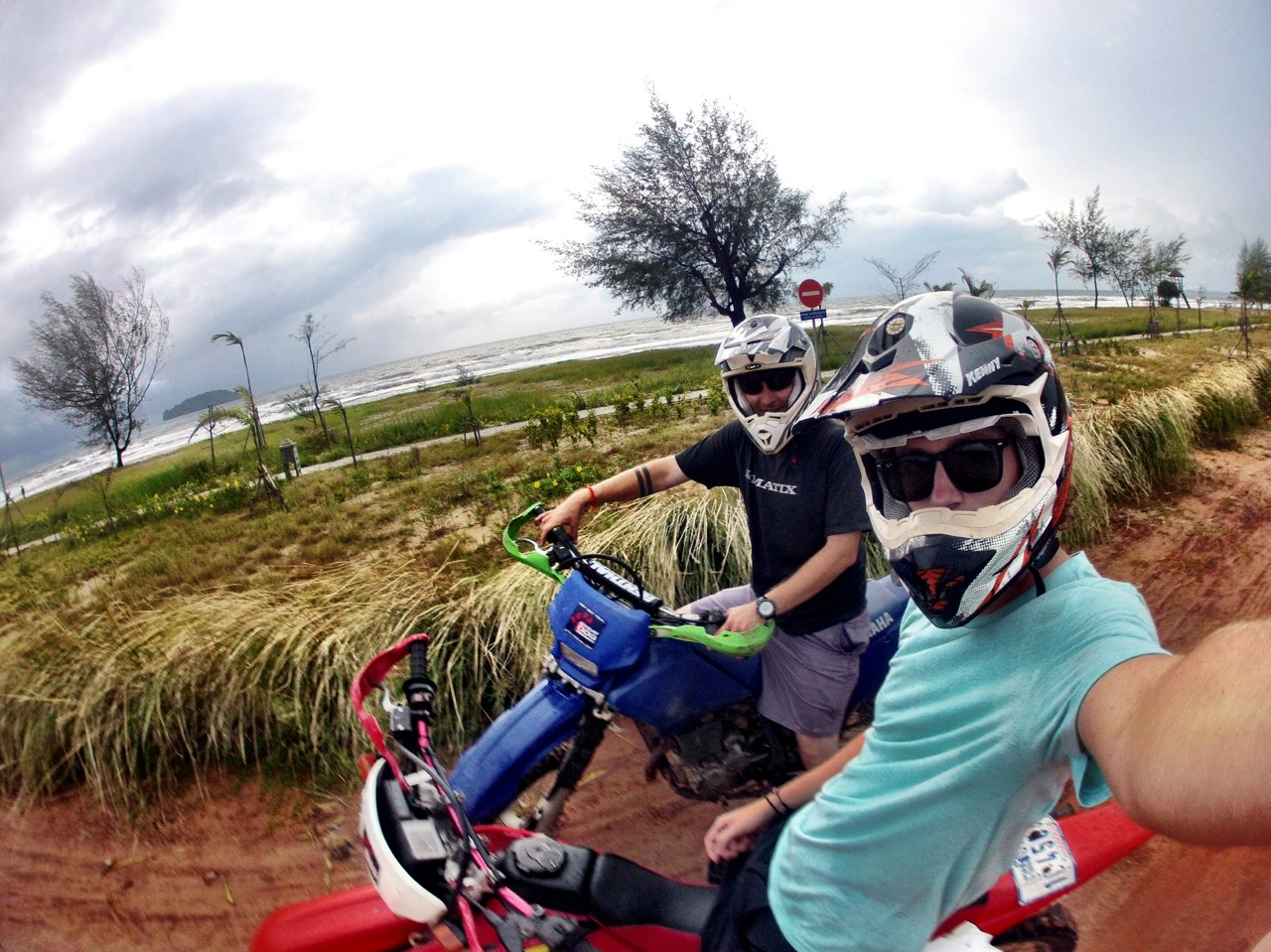 Jeff and his brother Chris riding dirt bikes in Cambodia