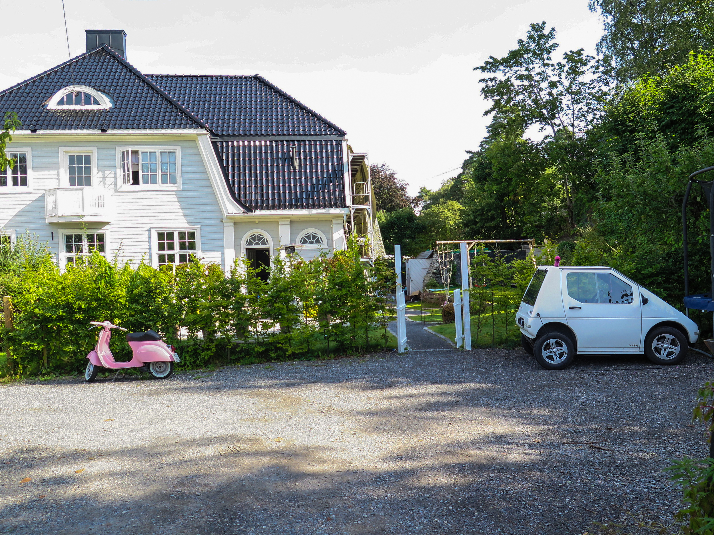 Traditional Norwegian home, mini electric car included. We were surprised by the amount of Teslas and other electric cars here.  In Norway if you own an electric car you can drive in special lanes and get free parking anywhere without meter fees.