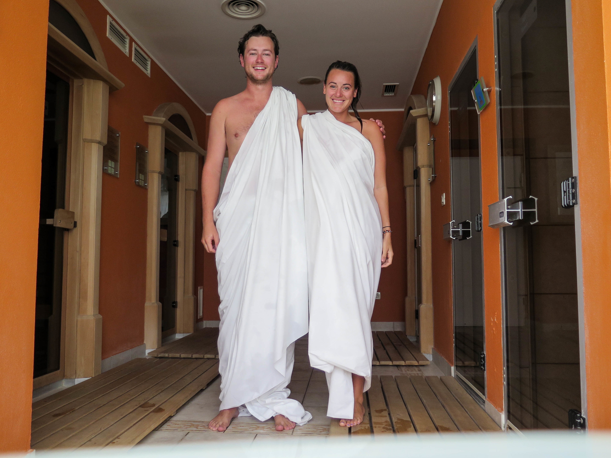 "All smiles wearing our ""togas"" in the saunas."