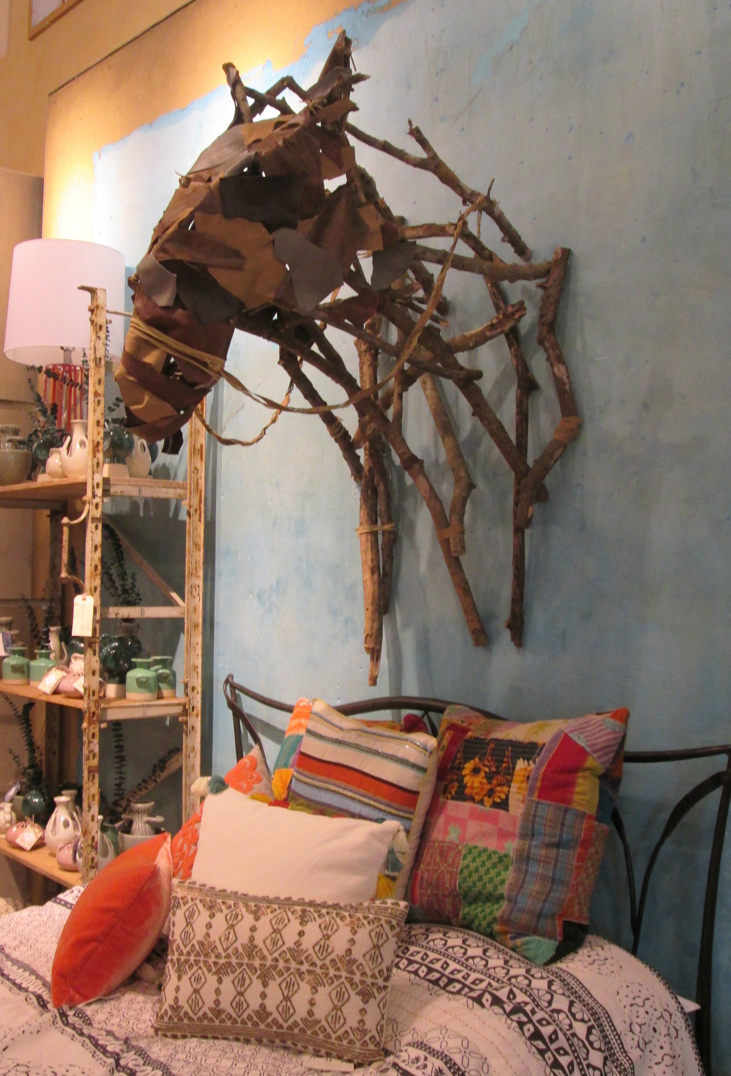 branches, leather scraps, tacks, string