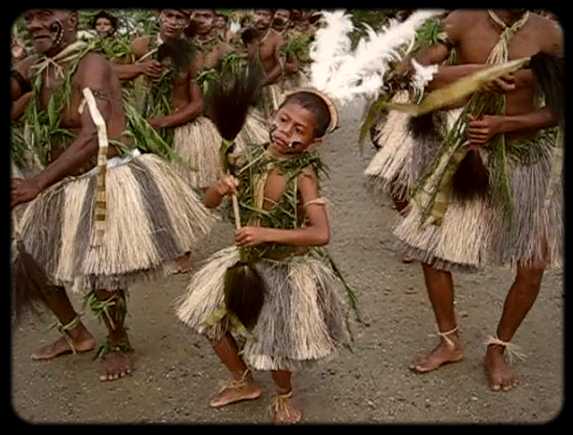 Still of archive footage of a dancer from Liak, Misima Island. Videographer and copyright unknown (2008).