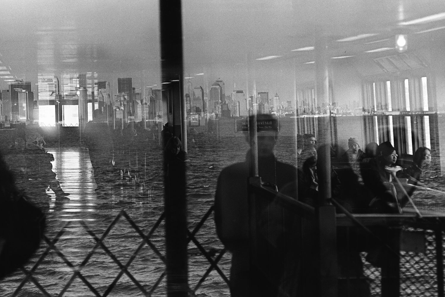 Reflection in awindow of the Staten Island ferry  New York, NY. 2002