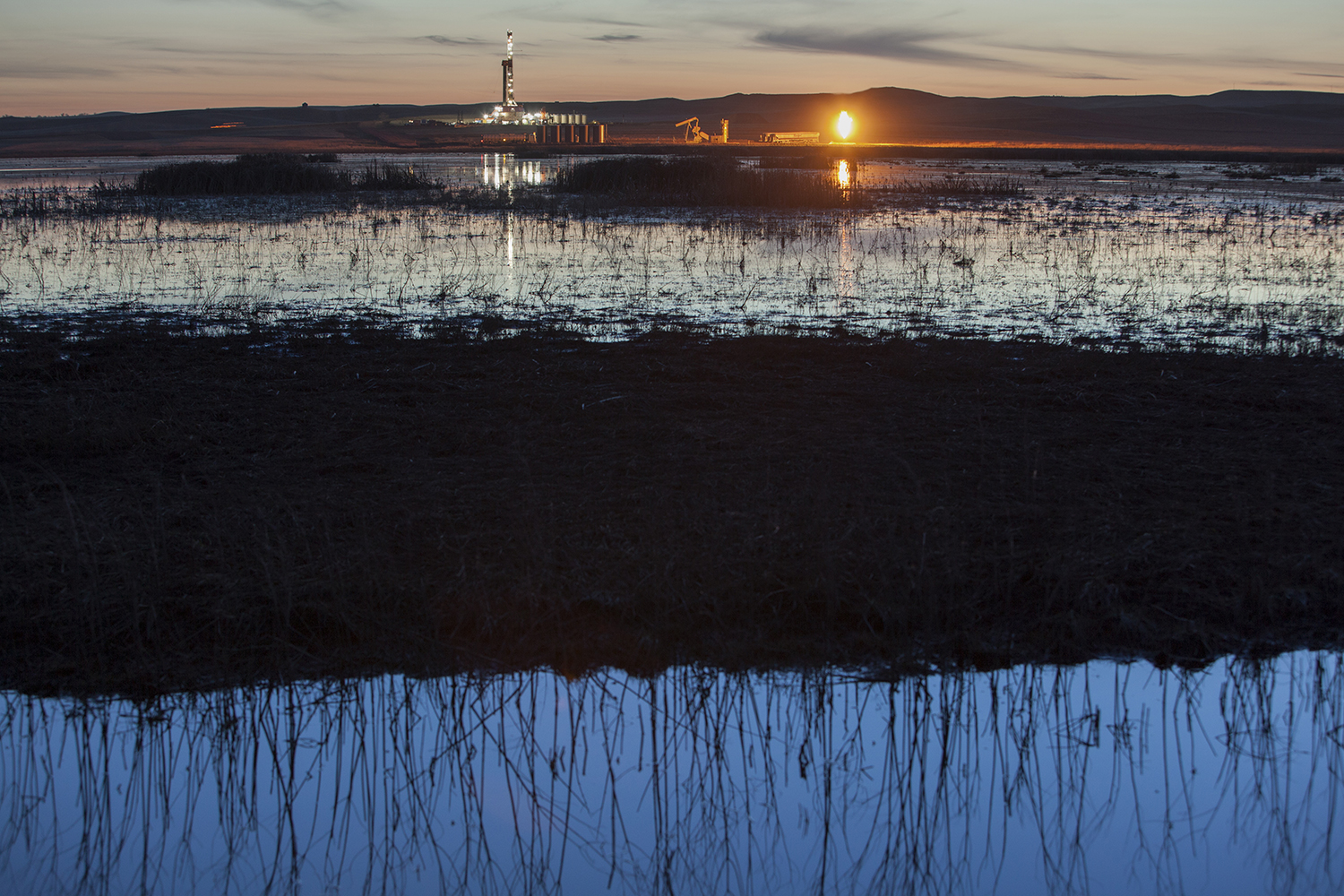 An oil rig and gas flare  North of Watford City, ND. 2012