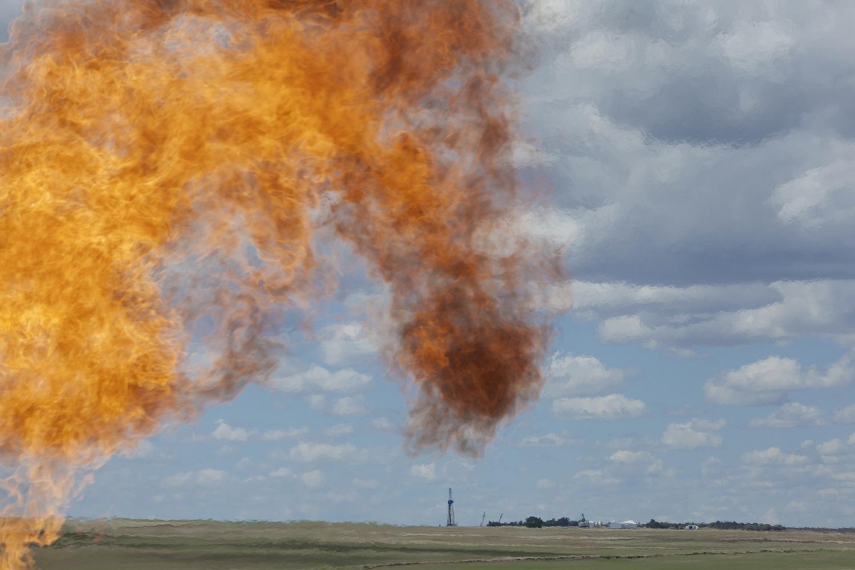 Natural gas flare near oil pump  Williston, ND. 2012