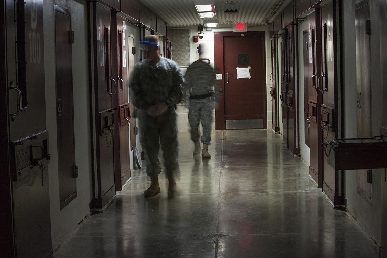 5 a.m. Bravo Block Camp V. Guards monitor detainees during twenty-minute call to prayer  Guantanamo Bay Detention Camp Caimanera, Cuba. 2013