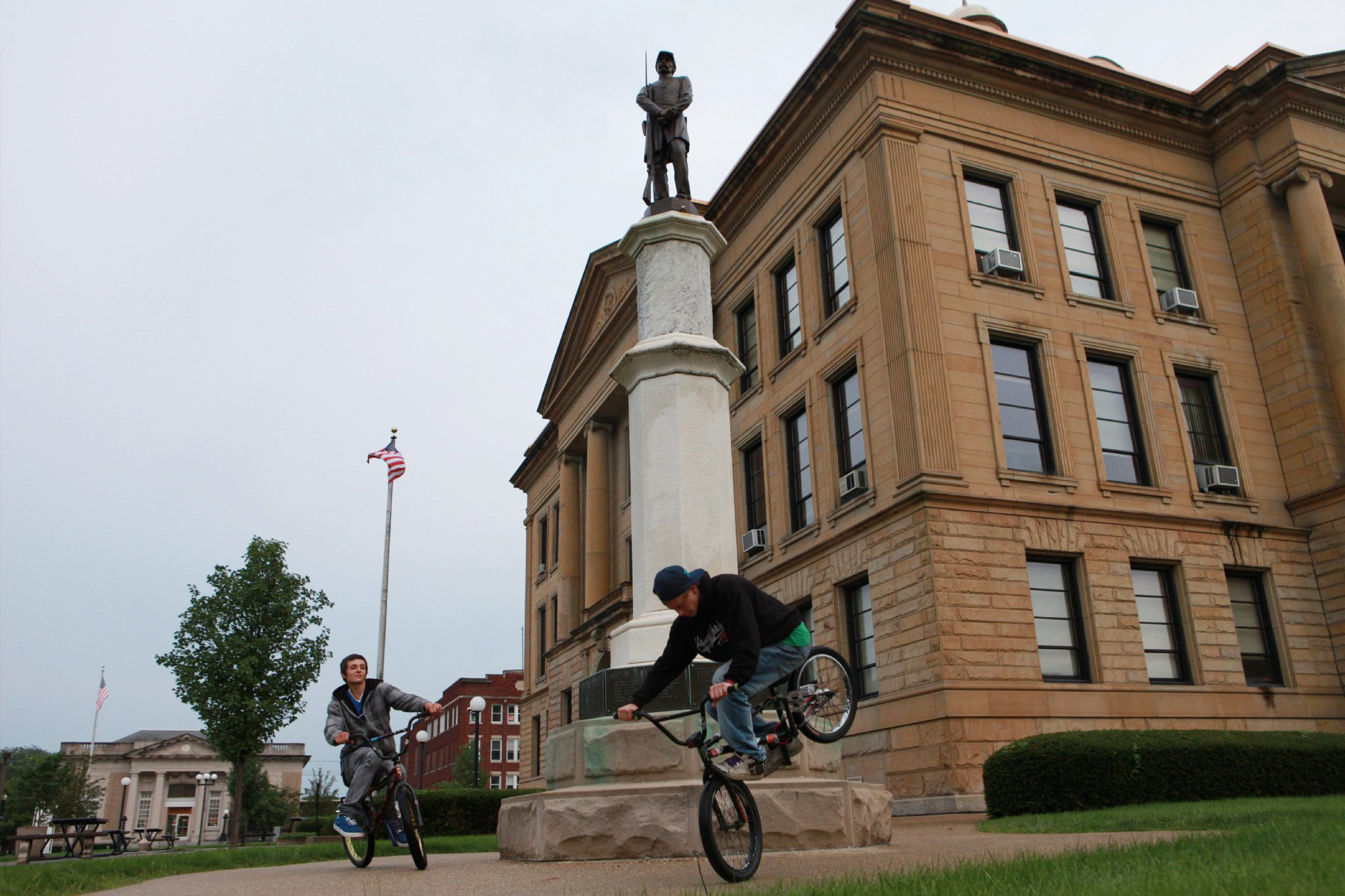 BMX bikers circle the Logan County Civil War Monument  Logan County Court House Lincoln, IL.  2014