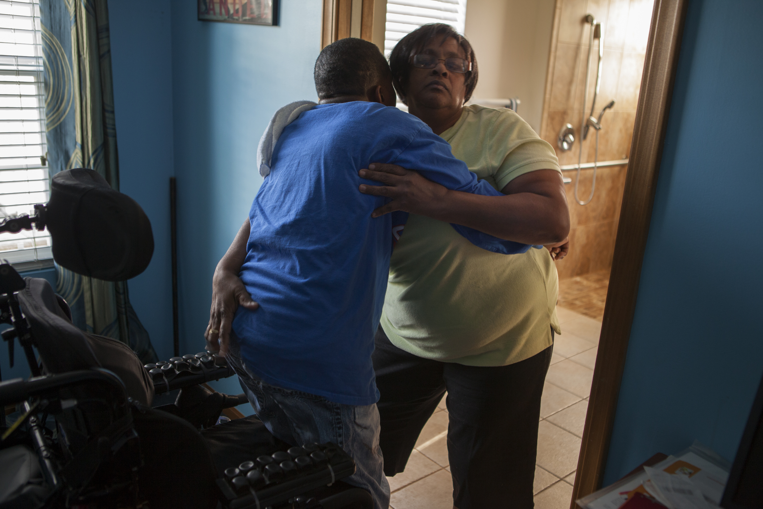Severely wounded Iraq War veteran Shurvon Phillip and his mother Gail Ulerie  Richmond Heights, OH.  2014