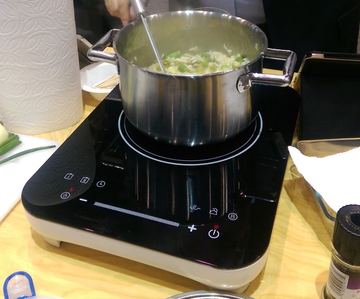 The Cucianale Intelligent Cooktop cooking risotto at IHA