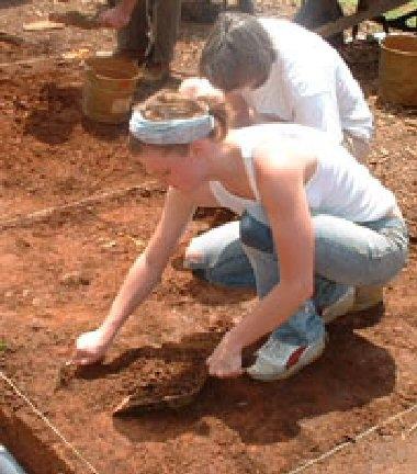 Removing the soil, centimeter by centimeter.