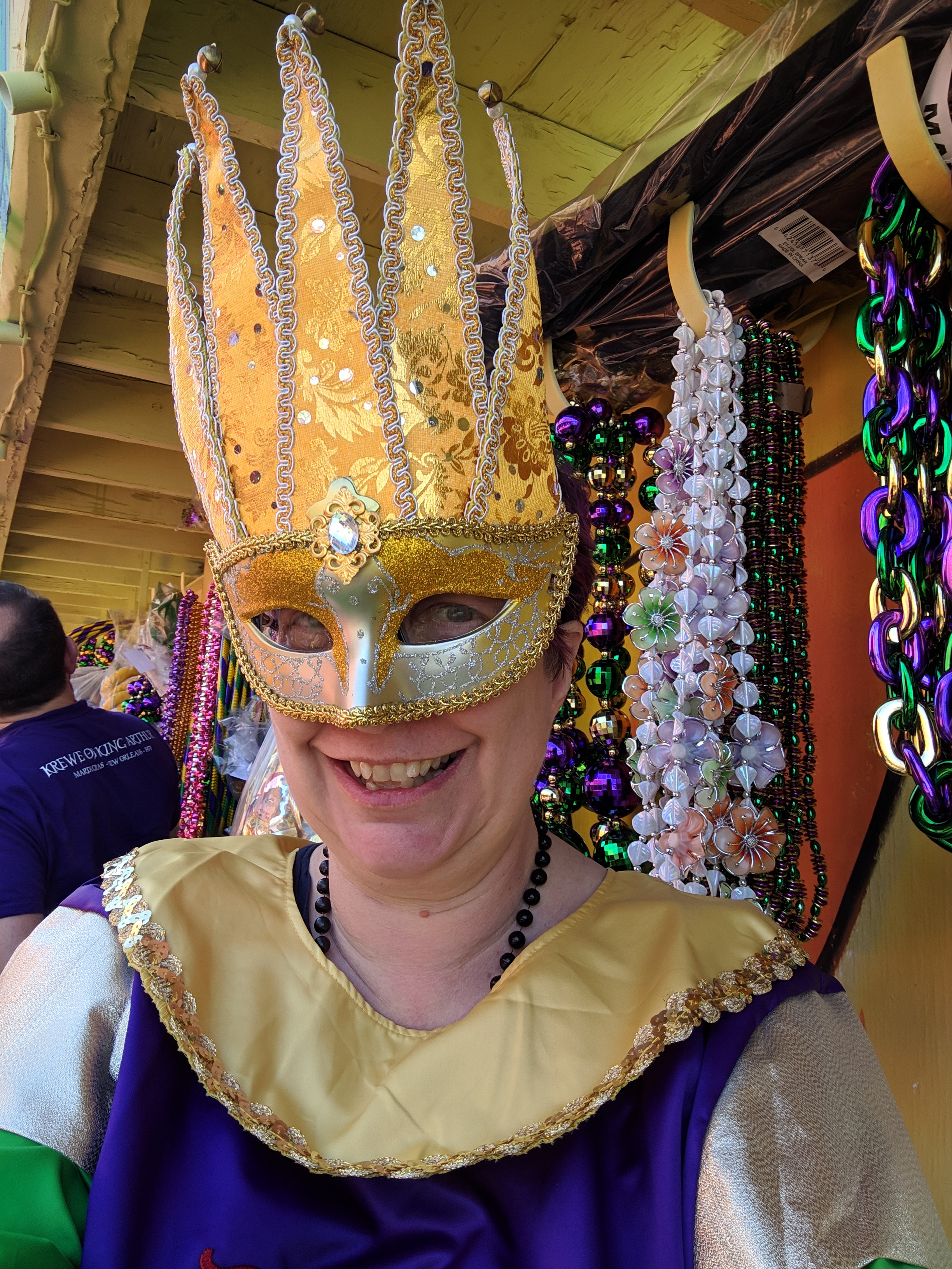Our tunics mark us as Krewe of King Arthur; our masks tell you who's in charge of our particular floats.