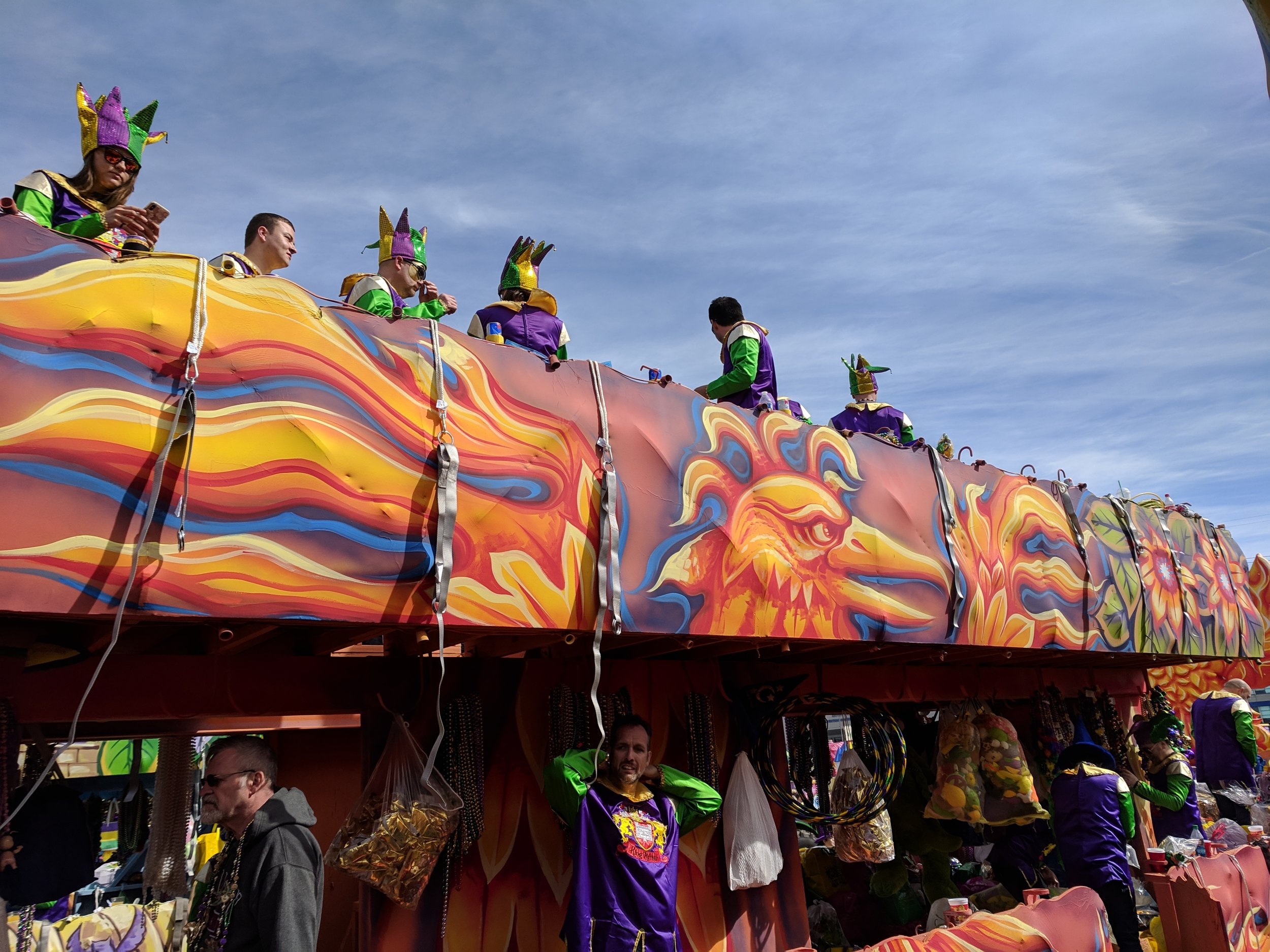 The riders on the top of this float indicate that they have their harnesses ready to wear.