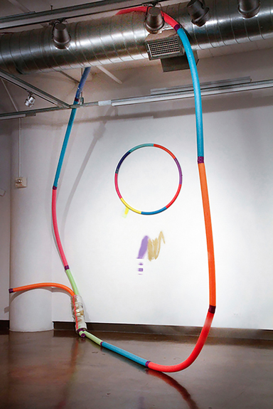 How do we hula hoop now?, 2013; Swimming pool noodles, tape, found furniture, found hula hoop, Variable Dimensions.