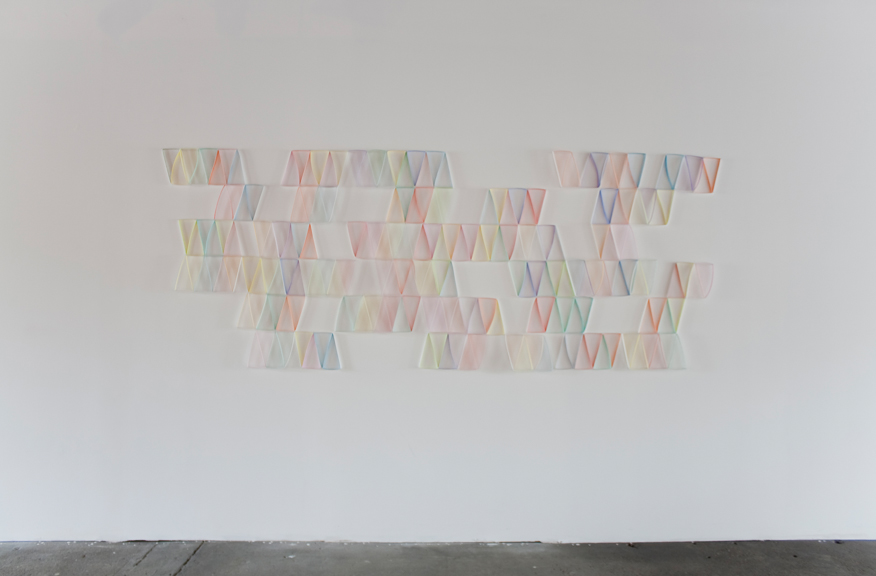 Modular Wall Installation: Parallelogram (Half)  gouache, colored pencil, paper, nails  Dimensions variable  2015  Installed at Ball & Socket Art Garage, 2015 (approx. 4 x 10.5 feet)