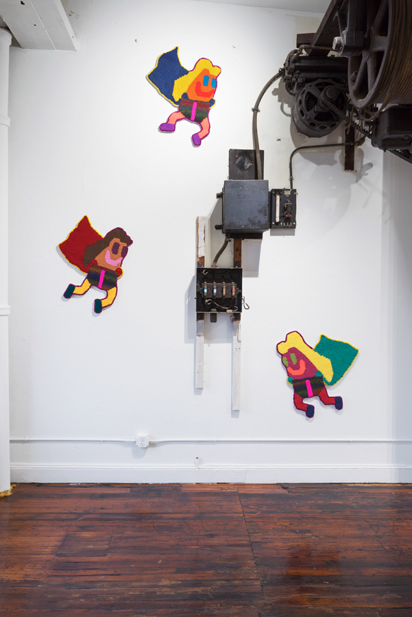 """Install shot from 'Beach Bois' at Lord Ludd in Philadelphia, PA   Flying Trolls: Simone, Kathy , and  Stacey   Hand crocheted assorted fibers  26"""" x 32"""", 28"""" x 32"""", x 30"""" x 32""""  2016"""