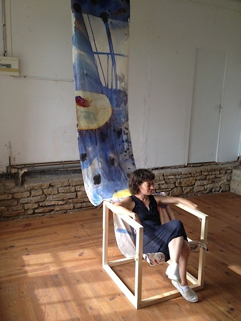 Installation Shot:  The artist, in a collaborative painting-speaker-chair, made with Woody Sullender.